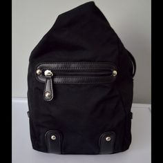SALEEtienne Aigner Backpack Handbag Solid Black Etienne Aigner Backpack Handbag Solid Black pre owned some wear on the straps. Length 8 in  Height 12 in Depth 3 in  Adjustable straps Etienne Aigner Bags Backpacks