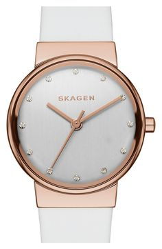 Bright crystals add just a touch of sparkle to this clean, minimalist white and rose gold watch.