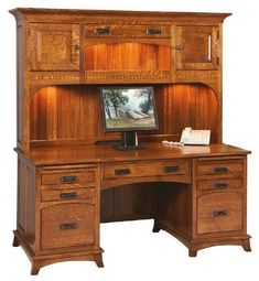 Amish Mt. Eaton Mission Executive Desk with Hutch Top Stunning and solid, the Mt. Eaton is in charge. Features include option to add a hidden compartment, hutch lighting, keyboard pullout, shiplap back and much more. Amish made in America. #desk #deskhutchcombo #executivedesk