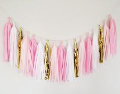 Our soft and pretty pinks, blush, white and gold tassel garland adds the perfect amount of glitz and glam to your decor!  We see this tassel garland 28.29