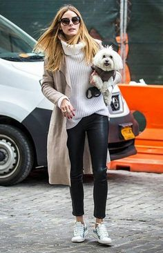 Olivia Palermo wins at dog-walking style in a chunky sweater, trench coat, leather pants, and Moncler Gamme Rouge Muguet Sneakers