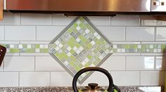 This is the backsplash at my new house. It is pale gray subway tiles with green mosaic glass tiles. Really pretty