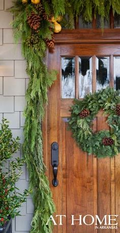 holiday entry with fresh greenery from the At Home in Arkansas magazine