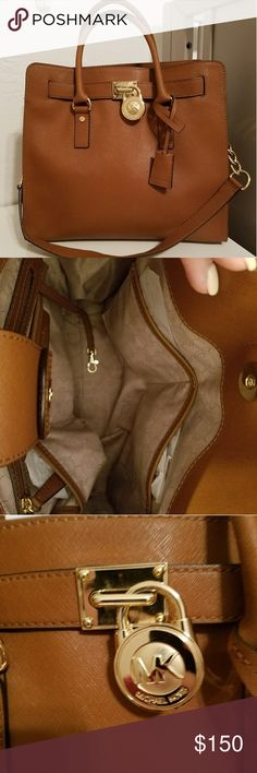 Luggage Tan Michael Kors Hamilton Large Satchel Excellent used condition. Handles are perfect. Leather is amazing. Inside is super clean. Gold hardware. Light wear on lock. Authentic with serial code inside to verify authenticity. Michael Kors Bags Satchels