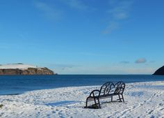 Bench, snow and sea view