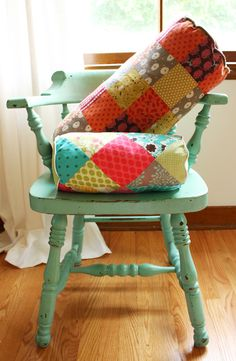 DIY: patchwork bolster pillow. would look great with a yo-yo pillow and ruffled bedpread!