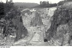 The granite quarry at the Mauthausen Concentration camp.The Wiener Graben stone quarry, originally owned by the City of Vienna, was rented in April 1938 by the SS and taken over by the SS company Deutsche Erde-und Steinwerke, in August of that year. One of the main reasons for the selection of Mauthausen as a site for a concentration camp was the stone quarry.