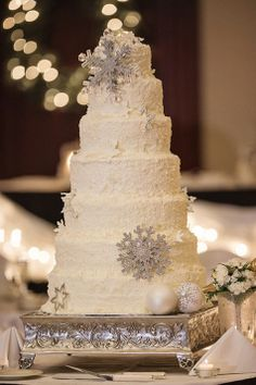 Seven layer white wedding cake with white chocolate shavings and snowflakes