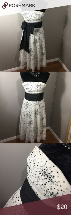 Dress Adorable strapless cocktail dress 👗 long attached black sash can be worn many ways! Back zip, from smoke free home 🏡 small stain on INSIDE of dress, unseen from outside. BCBGMaxAzria Dresses Strapless