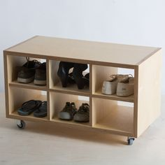 Birch plywood cubby for books, shoes or coffee table. Modern storage idea that is on castors so can be moved to suit. Made in NZ