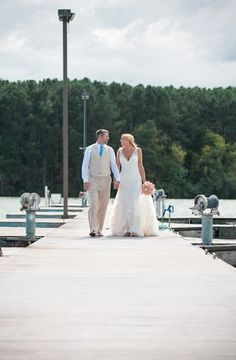 How amazing does this couple look on this dock! Such an fantastic picture at the perfect wedding venue, Tellico Village Yacht Club! Contact them today to see what all the fuss is about! Photo credit: Michelle Honeycutt Photography