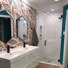 Colorful wallpaper in a modern bathroom? Why not! Try a modern design with a high quality removable wall mural. Intertwining colours peel&stick wallpaper - geometric patterned wall decor #colors #colours #wallpaper #bathroomdecor #bathroomideas #bathroom #bathroomdesign #modernbathroom #moderndesign #moderndecor #Moderninterior #modernideas #Peelandstick #removable #wallmural #walldecor #colorful