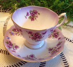 Royal Albert Dainty Dina Series. JENNIE. Lovely Violets on purple ombré bone china. Truly a beautiful teacup and saucer. The delicate violets are absolutely gorgeous. Would make a wonderful gift for that special Jennie in your life or a great gift for yourself! Excellent condition. No gold loss, chips, or crazing. Ping very nicely. Please look at photos carefully as they are a part of my description. Note. Actual color may differ from the photo due to lighting conditions. NOTE: with items...
