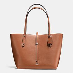 Beautifully constructed in refined pebble leather with a luxuriously soft hand, this spacious tote is finished with slender contrast handles, workwear rivets and a strap closure secured by a petite Coach turnlock. The interior is left unlined to show the reverse of the exceptional leather used to craft its simple, elemental shape.