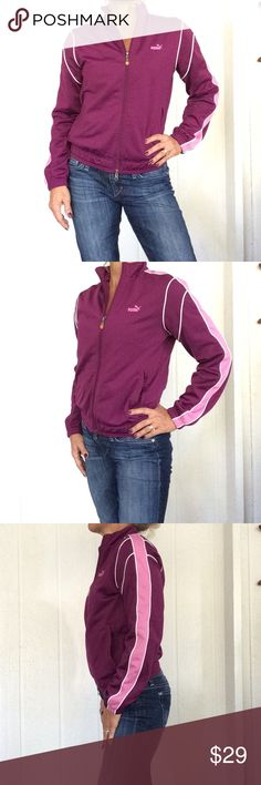 PUMA TRACK JACKET Gorgeous shade of deep purple/cranberry Puma zip up track jacket. a EUC. Jacket has contrasting pink and white stripe down sleeves and white piping at shoulders. Jacket has stretch to it.  Full zipper elastic at cuffs and waist. Puma Jackets & Coats