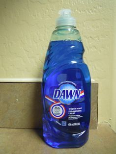 1/2 cup white vinegar heated in microwave 1/2 cup blue Dawn dish detergent Combine in spray bottle. Spray on shower door and let sit several hours. Wash off! Removes soap scum.