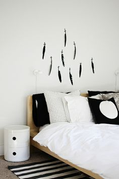 feather wall by AMM blog, via Flickr- lovely idea! If you are looking for solid wood beds and soft cotton bedding try: www.naturalbedcompany.co.uk