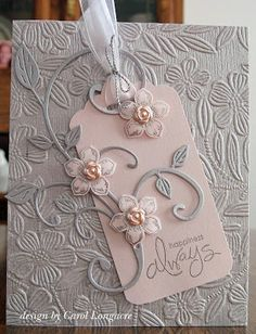 DIY card using Embossing Folder background design layered with a tag and topped with a flourish leaves die cut.
