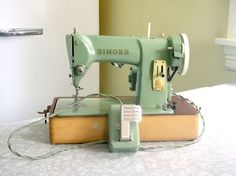 Mint green singer!!! - this takes me straight back to my childhood when we 4 sisters would share my mom's singer :)