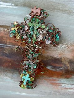 Cross 0f Crosses Crucifix - 4 Inch Rusty Wall Cross. $32.50, via Etsy.