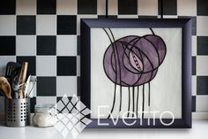 """Charles Rennie Mackintosh (1868-1928), a Scottish architect, designer, water colourist and artist, was one on the most important Art Nouveau representatives. Mackintosh, magnificently, combined slender curves, soft opalescent colors, clean vibrant geometric frameworks and stylized distortions. Roses will always be a symbol of grace and elegance. Purple is a color associated with elegance and grandeur. """"Charles' Purple Rose"""" is a romantic and opulent tribute."""