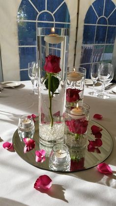 Candle wedding centerpieces - Submerged, single flowers to be one of each coloured rose Floating Candle Centerpieces, Rose Centerpieces, Votive Candles, Wedding Table Centerpieces, Wedding Decorations, Red Table Decorations, Floral Wedding, Diy Wedding, Wedding Ideas
