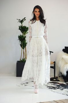 This lacy ensemble from Houghton. | 17 Simply Stunning Sheer Wedding Dresses