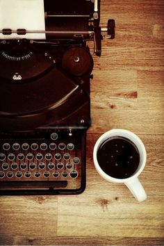 A writer's essential tools ... or at least some of them. (Something to write with and a coffee)