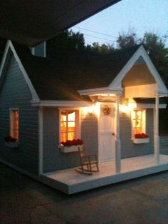 Playhouse built it once and sold the house, had to leave it behind because it wouldn't fit on a truck easily.  So if you are building this, watch the outside dimensions.  This one was 14' x 14' including the deck and 12' tall.  I will build another one!  The front door is a dutch door and the side window was arranged in the internal wall to be cut into a man size door when the kids out grew the playhouse allowing it to become a gardening shed.  There is a loft inside.