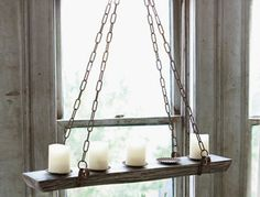 "HACKABLE :: Refectory Hanging Candelabra :: $82 | antiquefarmhouse.com :: [36"" x 10"" x 44""h] Metal & wood :: You could DIY this w/ a piece of barn or pallet wood, a shelf, etc. and some chain. Instead of the iron brackets/hooks, you could screw in some upsidedown or sideways hooks into the top or sides of the wood. Glue on mini metal tart or pie pans for the candle plates. The would look really nice hung from one of those antique pulleys or block & tackle hooks. 
