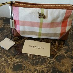 Authentic Burberry clutch Brand new burberry hand bag can be used as makeup bag, wallet or clutch . Never been used . Comes with tags Burberry Bags Clutches & Wristlets