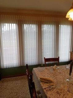 Vertical Sheers in the dining room. A great alternative to vertical blinds that blend in any room. #VerticalBlinds