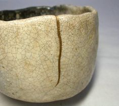 """Кинцуги - искусство """"золотого шва"""" Kintsugi (金継ぎ) (Japanese: golden joinery). Kintsugi is said to have originated in the 15th century when a Japanese shogun broke a favorite tea bowl and sent it back to China to be fixed. But the repair job, which was done with metal staples - being the standard for repair at that time - detracted from the beauty of the bowl. Disappointed, the shogun enlisted a Japanese craftsmen to come up with a more aesthetically pleasing solution"""