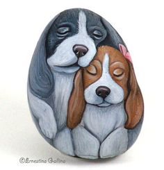 cute dogs painted on a rock