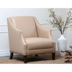 Enjoy this luxurious accent piece from Abbyson Living for years to come. With a versatile color and comfortable material, this leather armchair is the perfect addition to your home.