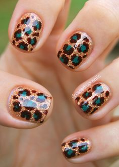 """These started with a base of China Glaze I Herd That. Then I used a large dotting tool to make dots with China Glaze Exotic Encounters. Finally I used a small dotting tool to do the brown outlines and random other brown spots. I topped it all off with two coats of Seche Vite because this glitter was HUNGRY."""