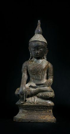 "Burma, old bronze sitting Ava Buddha. Seated in virasana on a high base, his right hand lowered in bhumisparshamudra – the gesture "" for the earth to witness""."