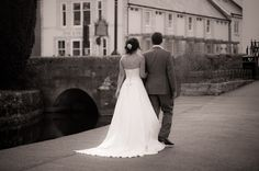 Bride and Groom walking through Christchurch. Weddings at The Kings Arms, Dorset