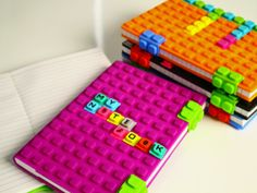 Silicone Notebooks and Alphabet Cubes.  By Kristins Gifts.    Pin from www.thegromet.com/%2Fkristins-gifts-silicone-notebooks.  The soft, portable notebook has 120 ruled pages in 2 sizes.  The waffle-like cover comes in bold colors.  The WAFF Notebook  Cubes. Additional  WAFF Cubes available