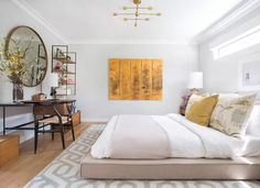 While some may view gray as a gloomy color, it can be a nice neutral for allowing other colors to pop, like this greige and gold combination. If you're thinking of giving gray a try, check out these lovely bedroom ideas.