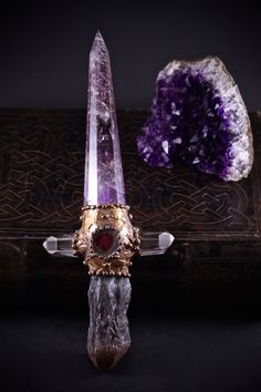 Ruavel, a fey blade forged of amethyst Knife Aesthetic, Witch Aesthetic, Swords And Daggers, Knives And Swords, Crystals And Gemstones, Stones And Crystals, Maquillage Phosphorescent, Crystal Sword, Pretty Knives
