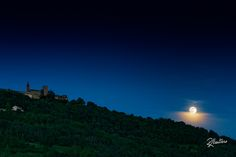 Moon over Riva    SUPPORT MY WORK! Just LIKE my Facebook page! Thanks!  The full moon, over a layer of clouds, rises over Rivanazzano Hill, behind the castle, just in front of my home. A Curious phenomenon.