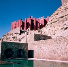 La Muralla Roja is an apartment complex set on the rocks in the coastal town of Calpe, Spain. it was designed by Ricardo Bofill and built in 1973.