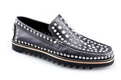 Mocassin with studs and vibram sole.