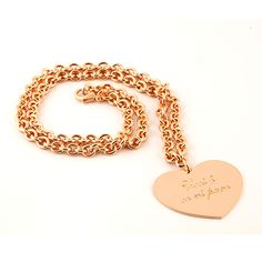 Round Link chain necklace with a heart pendan.