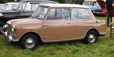 Riley Elf, British Motors Corp. side profile. Laguna Beige or thereabouts Beige. White top. Released in 1961 as more luxurious versions of the Mini, both the Wolseley Hornet and the Riley Elf had longer, slightly finned rear wings and larger boots that gave the cars a more traditional three-box design.