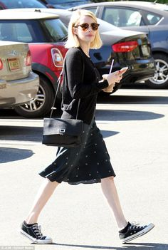 Casually sweet: For their lunch, the petite star wore a dark flowing dress with a fitted c...