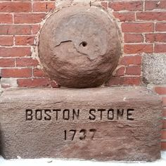 Faneuil Hall Hiding in plain sight along Marshall St (near The Green Dragon) is the Boston Stone, an object of disputed origin and significance. It's 2ft in diameter and hollow, and was most likely used as a small millstone circa 1700. Local lore suggests that surveyors used it as the epicenter of Boston, but math and history nerds think otherwise. Spoiler alert for National Treasure Part 8: the inscribed date (1737) is also a mystery!!!