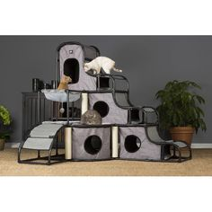Features:  -Cats will engage in frisky and healthy activity playing with the dangling toys, scratching the posts or climbing in, out, over and around the tower.  -Four hideaways on three levels - a pe
