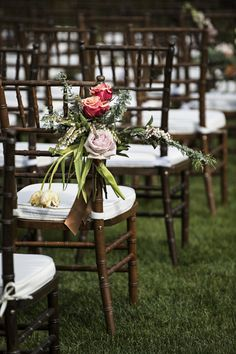 Lauren Brown Photography Bouquets of fresh roses, pieris and eucalyptus were tied to Chiavari chairs. Venue: Rainbow Ranch Lodge Event Planning: Molly Eckman Floral Design:
